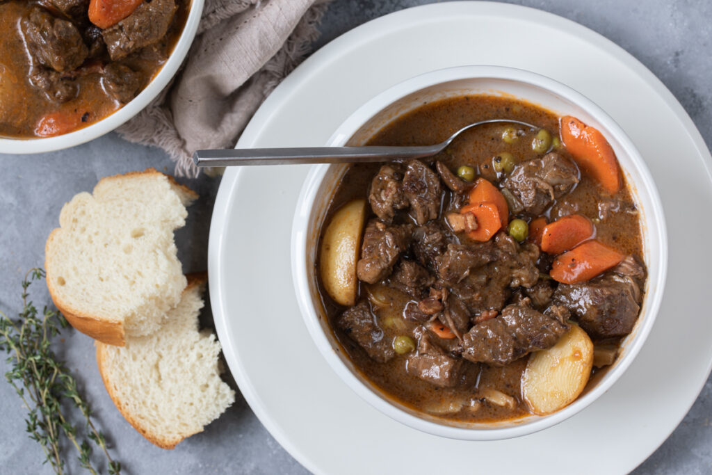 Dutch Oven Beef Stew Served with Peas and Mushrooms